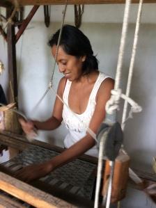 Abrazo Style Oaxaca artisan Carmen weaving a scarf by hand.